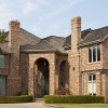 luxury brick home in the suburbs of North America