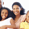 Portrait of happy African American family of four smiling together