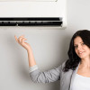 Beautiful brunette shows up on a new air conditioner
